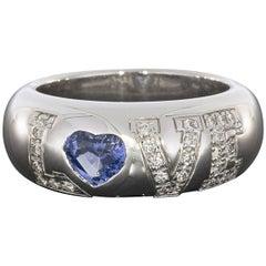 Chopard 18 Karat White Gold 0.75 Carat Sapphire and Diamond LOVE Ring