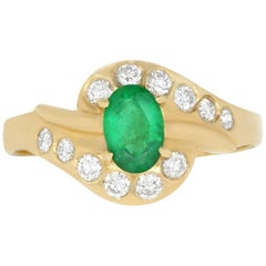 0.42 Carat Oval Emerald and 0.25 Carat White Diamond Ring