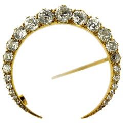 French Art Deco 18 Karat Gold Crescent Brooch with Diamonds, circa 1920s