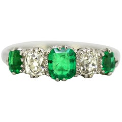 Art Deco Platinum Ladies Ring with Emerald and Old Cut Diamonds, circa 1920s