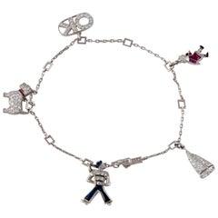 Platinum Diamond Ruby Sapphire Charm Bracelet