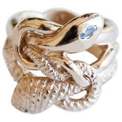 """""""Eternal Renewal"""" snake ring in bronze with white sapphire, emerald and rubies"""