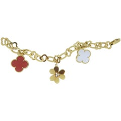 Van Cleef and Arpels 18 Carat Yellow Gold, Diamond, Coral and MOP Charm Bracelet