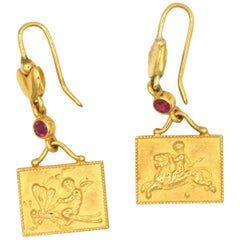 Renato Cipullo Ruby and Gold Cupid Earrings