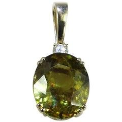 Oval Sphene and Diamond Pendant