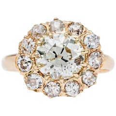 Victorian 1.57 Carat Old Mine Cut Diamond Gold Halo Engagement Ring