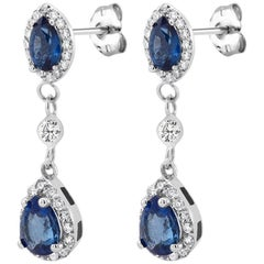 White Gold Halo Pear Shape Sapphire Diamond Drop Earrings