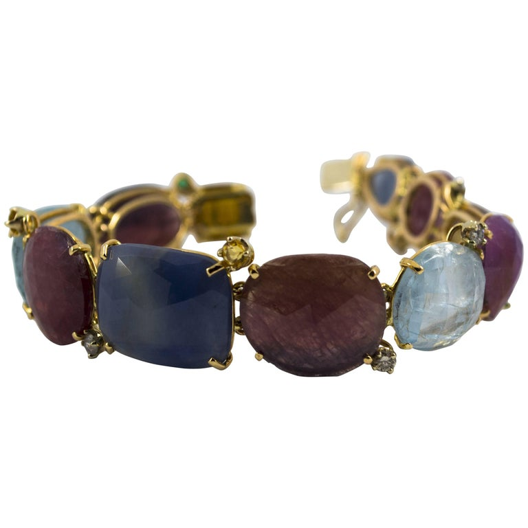 0.50 Carat Diamond 0.12 Carat Emerald Colored Sapphires Yellow Gold Bracelet