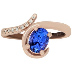 1.14 Carat Oval Tanzanite and 0.07 Carat White Diamond Ring
