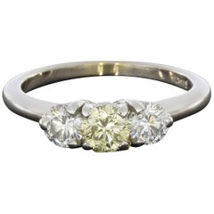 1.0 Carat Fancy Light Yellow Round Diamond 3-Stone Engagement Ring