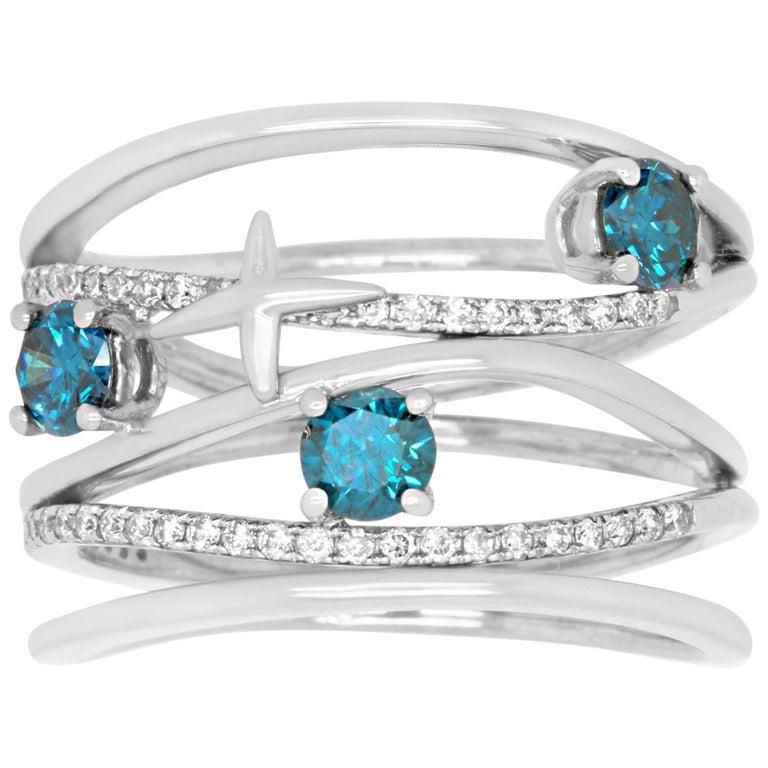 0.58 Carat Brilliant Round Blue Diamond and 0.22 Carat White Diamond Ring