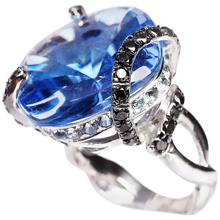 Special Cut 27.78 Carat Blue Topaz Black Diamond Cocktail White Gold Ring