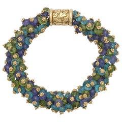 1980s Sapphire, Peridot, Tourmaline, Three Dimensional Flexible Gold Bracelet
