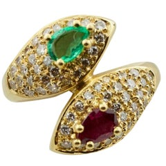 Ruby, Emerald and Diamond Crossover Ring in 18 Karat Yellow Gold