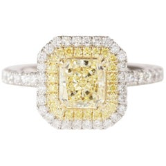 GIA Certified 1.11 Carat Fancy Yellow VVS2 Radiant Plat/18kyg Double Halo Ring