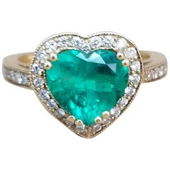1.68 Carat Heart Shape Emerald Set in 18 Karat Yellow Gold with Diamond Halo