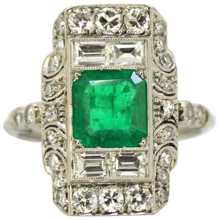 French Art Deco Platinum Ladies Ring with Emerald and Diamonds, circa 1920s