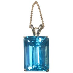 Large Swiss Blue 9.70 Carat Emerald Cut Blue Topaz Gold Pendant Necklace