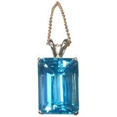 Large Swiss Blue 9.70 Carat Emerald Cut Blue Topaz Gold Pendant Necklace