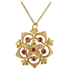Ruby and Diamond Flower Pendant on 9 Carat Yellow Gold Chain