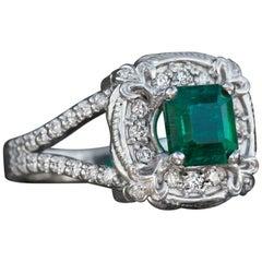 1.30 Carat Emerald and Diamond Theatre Ring in 14 Karat White Gold