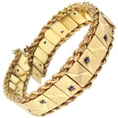 1950s Bracelet with Sapphires in Faceted Starbursts, 14 Karat Yellow Gold
