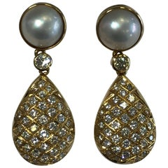 White Diamond and White Pearl Dangle Earrings in 18 Karat Yellow Gold