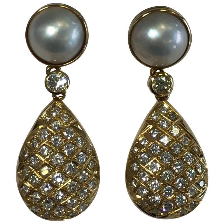 White Diamond and White Pearl Dangle Earrings in 18 Karat Yellow Gold