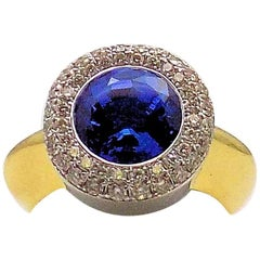 18 Karat Yellow Gold and White Gold Tanzanite and Diamond Ring
