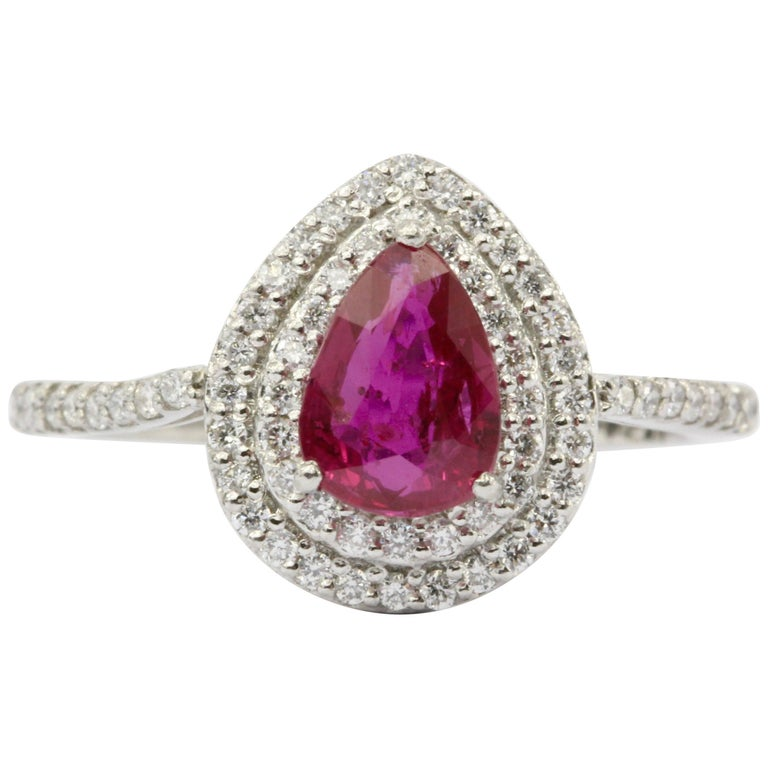 Platinum Ruby and Diamond Halo Engagement Ring