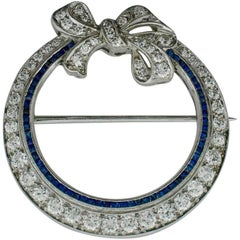 Art Deco Platinum Sapphire and Diamond Circle Brooch, circa 1920s