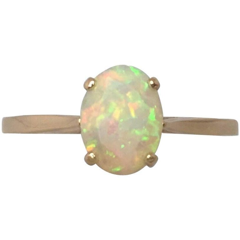 New Natural Oval Cut Fine Ethiopia Opal 0.71 Carat Gold Solitaire 14 Karat Ring