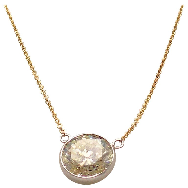 14 Karat White Gold and Yellow Gold Diamond Solitaire Bezel Set Pendant For Sale