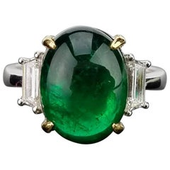 5.78 Carat Emerald Cabochon and Diamond Three-Stone Ring