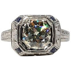 Art Deco 18 Karat 1.40 Carat European Cut Diamond and Sapphire Engagement Ring