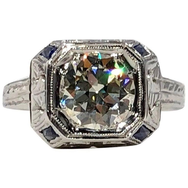 Art Deco 18 Karat 1.40 Carat European Cut Diamond and Sapphire Engagement Ring For Sale