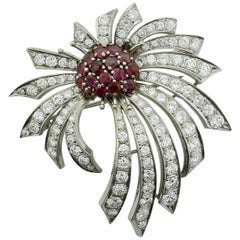 "Diamond and Ruby ""Fireworks"" Spray Brooch-Pendant in 18 karat, circa 1940s"