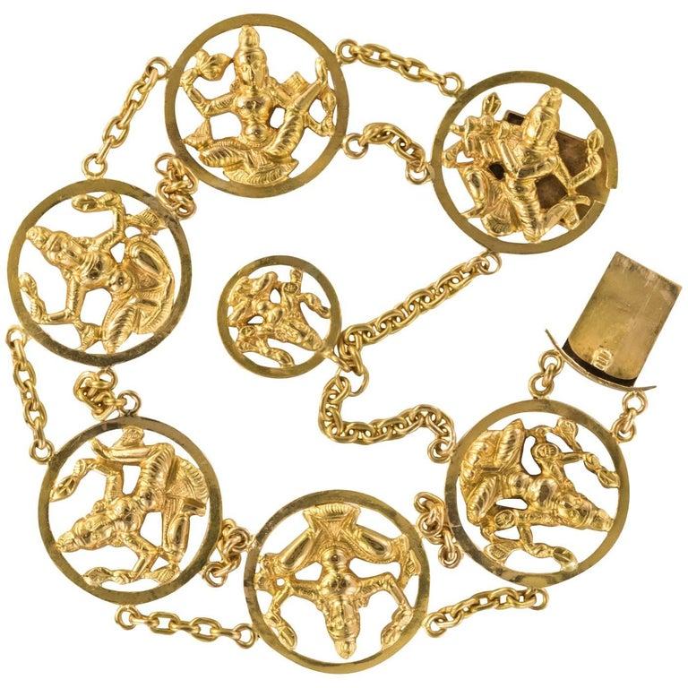1950s Indian Style 18 Karat Yellow Gold Charm Bracelet