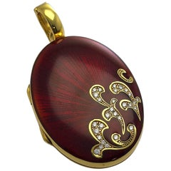 Modern Faberge 18 Karat Yellow Gold Diamond and Red Guilloché Enamel Oval Locket