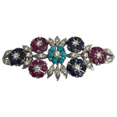 Gold 18 Karat Brooch Witt White Diamonds, Blue Sapphire, Ruby and Turquoise