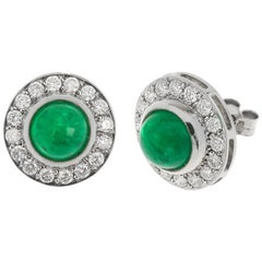18 Carat White Gold 4.19 Carat Emerald and 1 Carat Diamond Halo Earrings