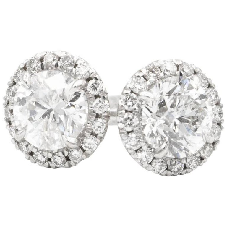 1.00 Carat Diamond Halo Stud Earrings in 14 Karat White Gold For Sale