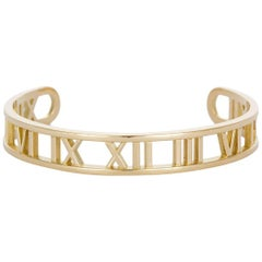 Tiffany & Co. Open Atlas Roman Numeral 18 Karat Yellow Gold Cuff Bracelet