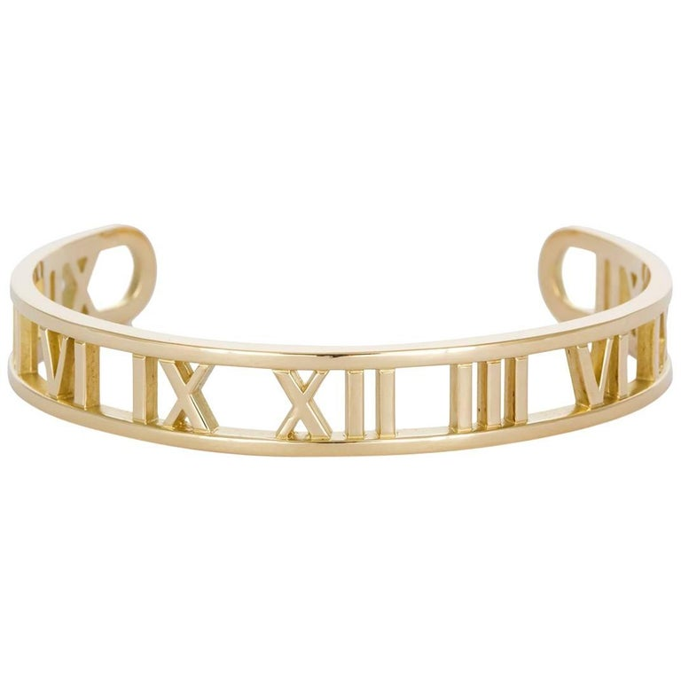 Tiffany Co Open Atlas Roman Numeral 18 Karat Yellow Gold Cuff Bracelet For