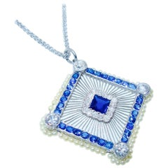 Edwardian Platinum, Sapphire, Diamond and Natural Pearl Pendant