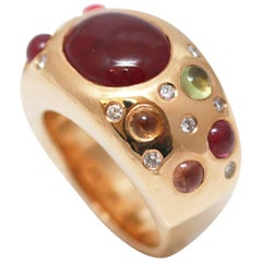5 Carat Cabochon Ruby, Diamonds and Sapphires Pave 18 Karat Gold Bombe Ring