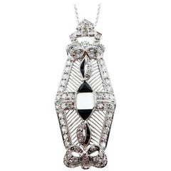 Art Deco Platinum Diamond Onyx and Moonstone Pendant