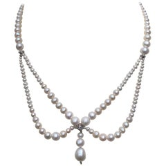 Graduated Pearl Draped Necklace 14 Karat White Golds Beads and Clasp by Marina J