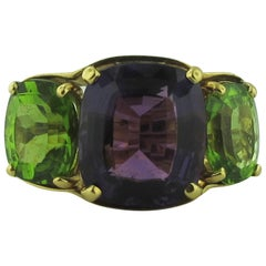 3-Stone Amethyst and Peridot Ring, set in 18 Karat Yellow Gold