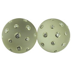 Round Rock Crystal and Diamond Earrings set in 18 karat yellow gold
